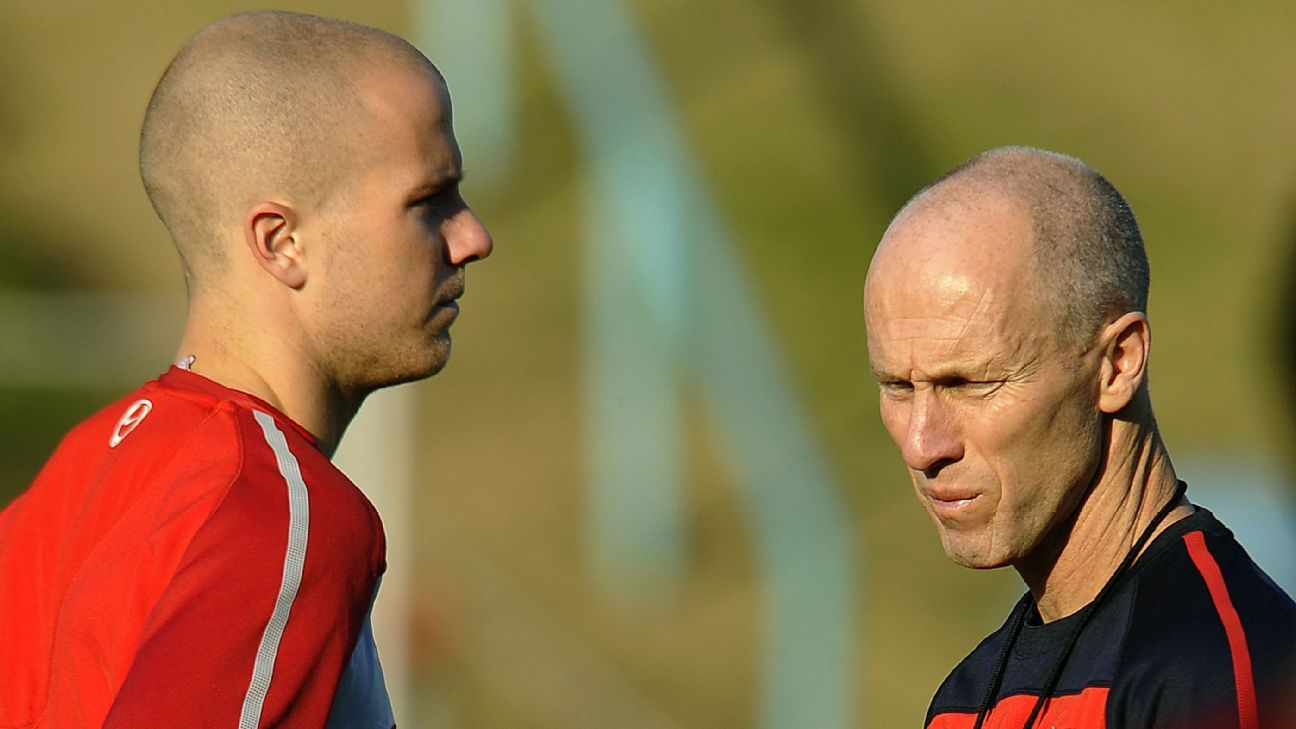 Michael Bradley and Bob Bradley chat after a U.S. training session during the 2010 World Cup.
