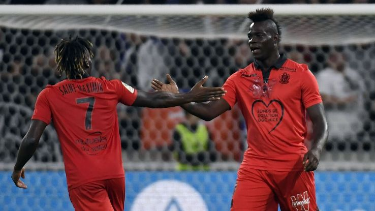 Nice midfielder Allan Saint-Maximin is congratulated by Mario Balotelli after scoring a goal.