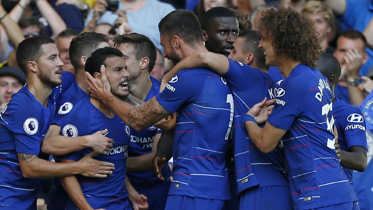 Chelsea players celebrate Pedro's goal in the Premier League game against Bournemouth.