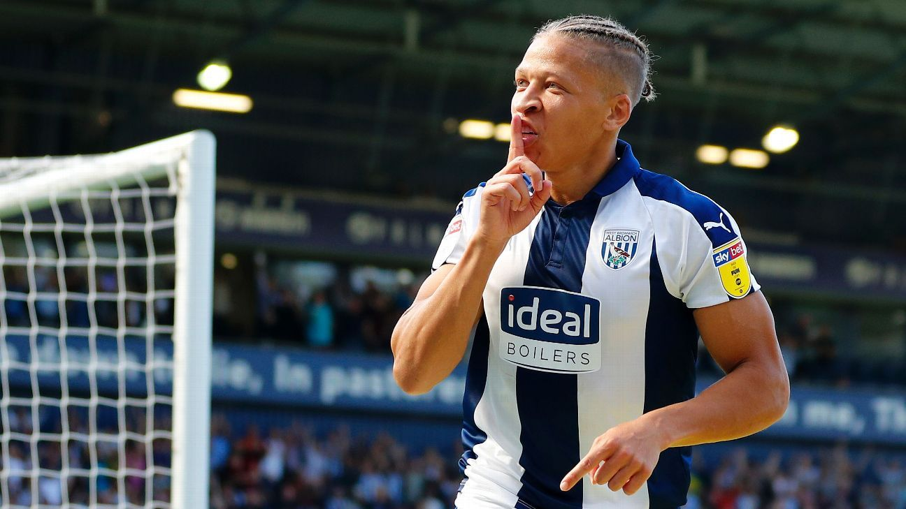 Dwight Gayle celebrates after scoring for West Bromwich Albion against Stoke.