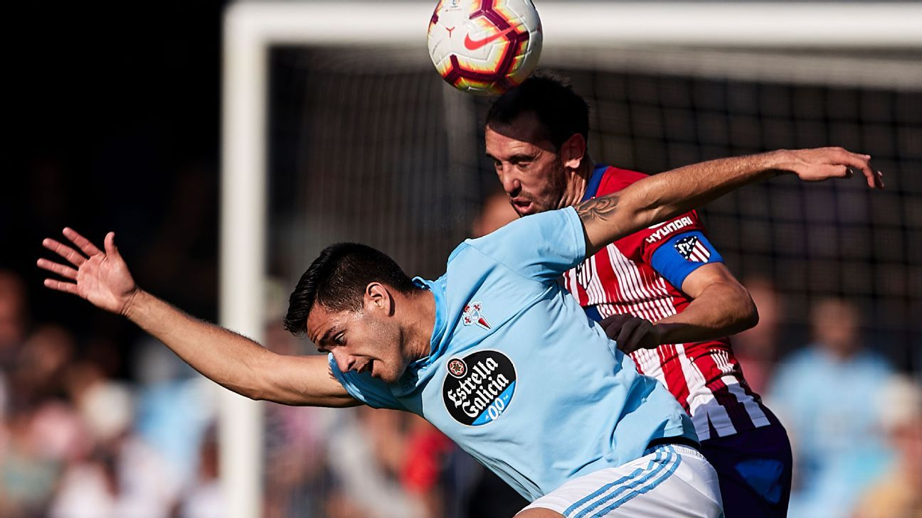 Diego Godin vies for the ball in Atletico Madrid's La Liga loss to Celta Vigo.