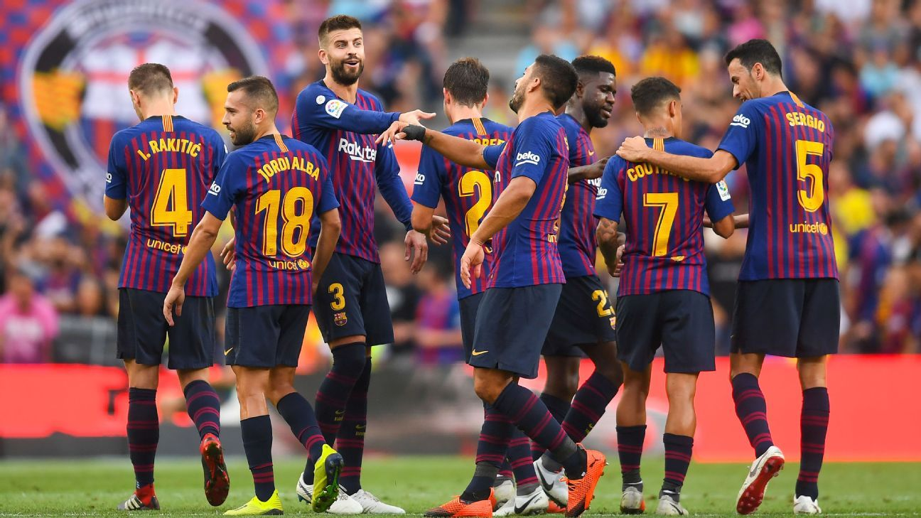 Barcelona players celebrate after scoring a goal against Huesca in La Liga.