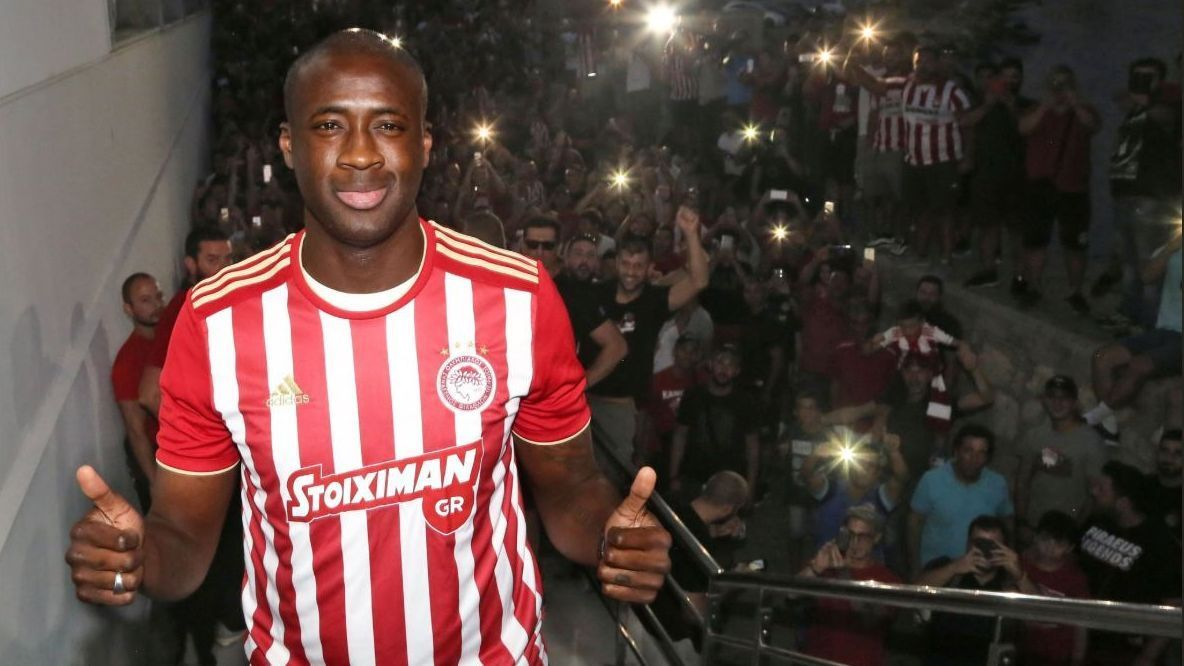 Yaya Toure is welcomed by Olympiakos supporters on his return to the club