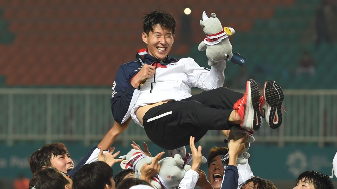 South Korea players toss teammate Son Heung-min in the air after the Asian Games' gold medal ceremony.