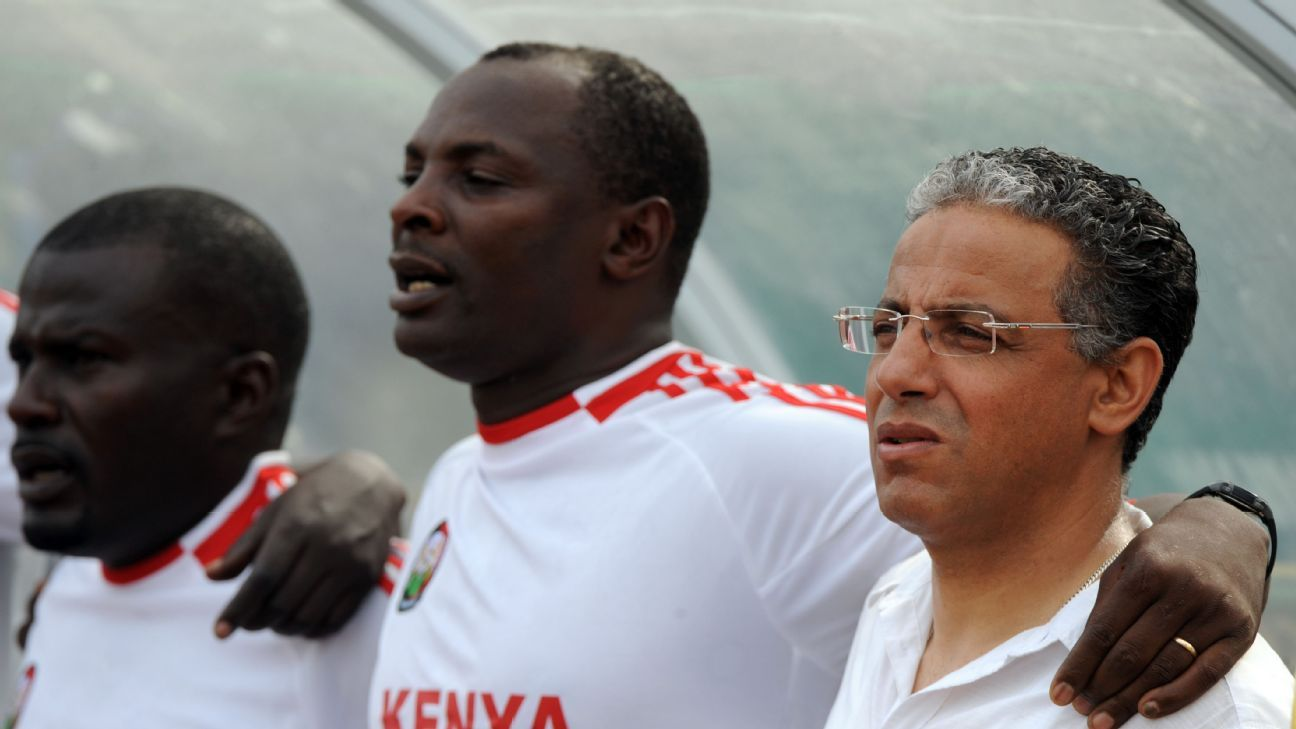 Former Kenya coach Adel Amrouche (R) stands with members of the technical crew