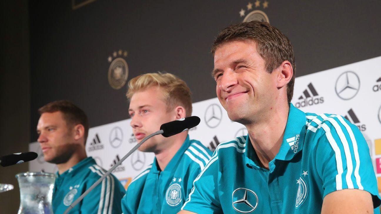 Germany's Manuel Neuer (left), Julian Brandt (center) and Thomas Muller.