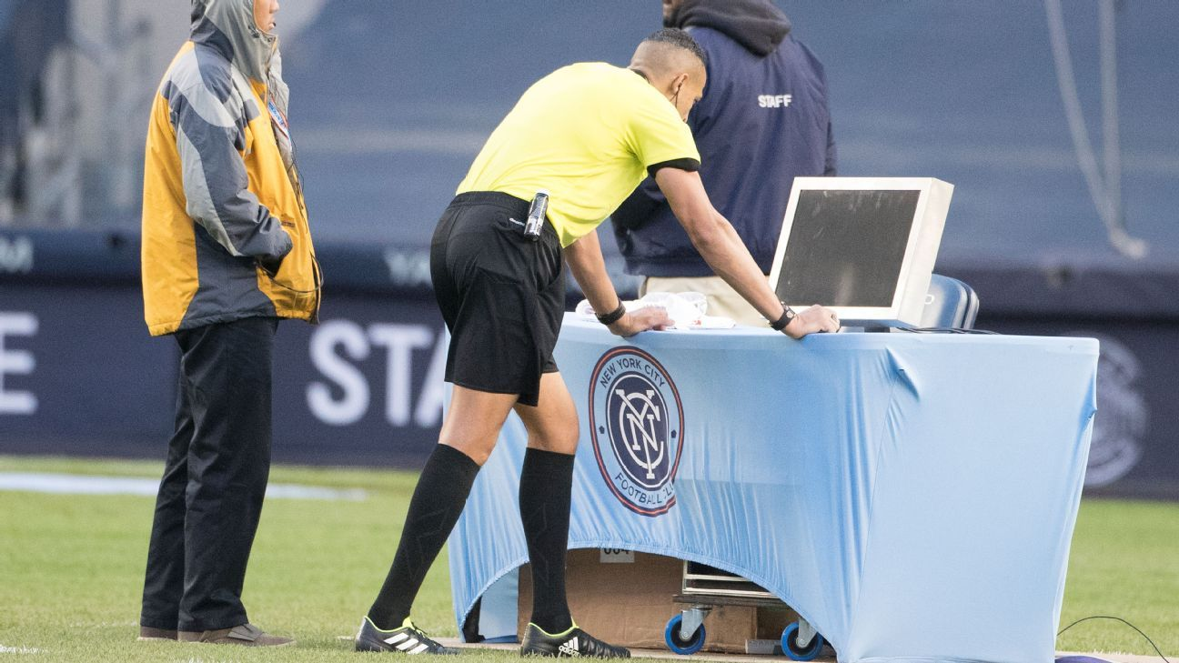 Referee Ismail Elfath reviews a play (VAR) before rewarding a penalty kick to New York City FC.