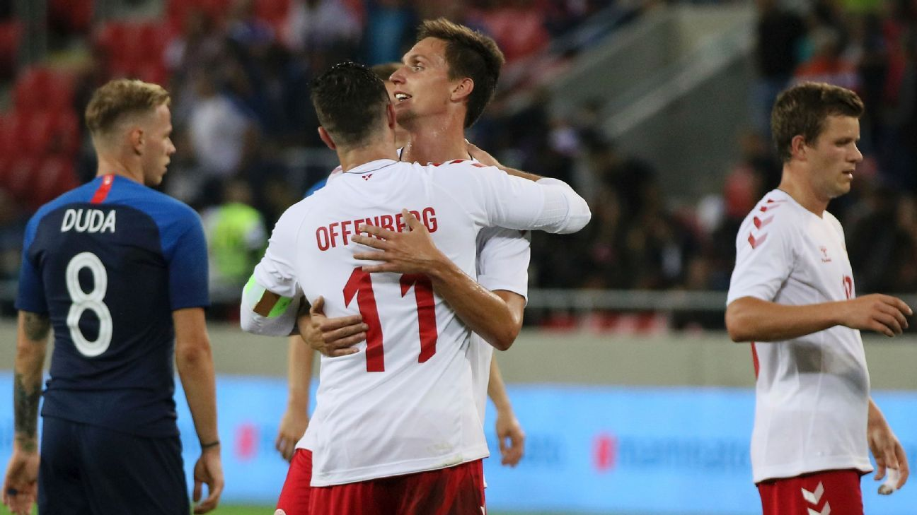 Danish players hug after losing to Slovakia on Wednesday.