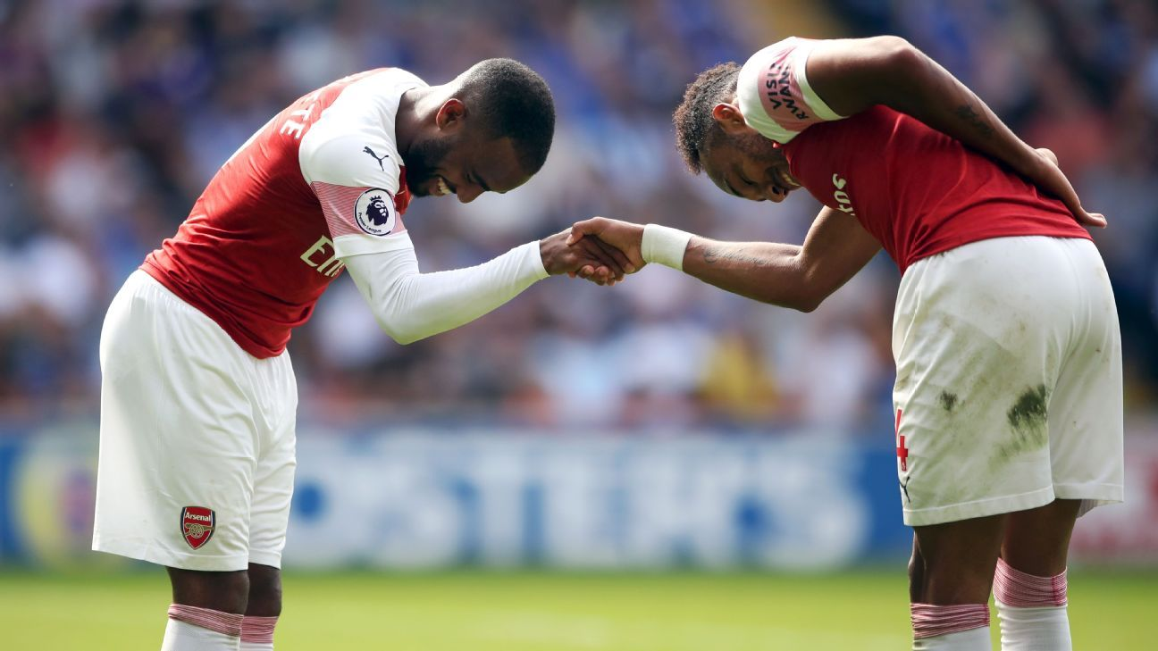 It's still early but Lacazette, left, and Aubameyang are fast forming the kind of striker partnership that can lift a club.