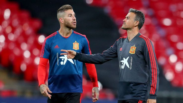 Luis Enrique, right, didn't even meet up with Spain captain Sergio Ramos, left, until the players arrived for the international break. It's by choice on the manager's part. He's in charge.