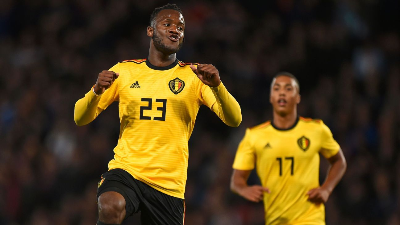 Michy Batshuayi celebrates one of his two goals against Scotland.