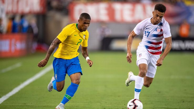 Antonee Robinson was one of the youngsters who found life difficult against Douglas Costa (pictured) and Brazil.