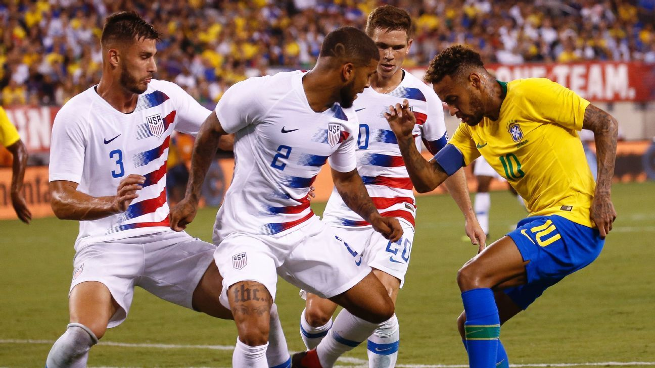 A trio of Americans attempt to stop Neymar in Brazil's 2-0 friendly win over the U.S.