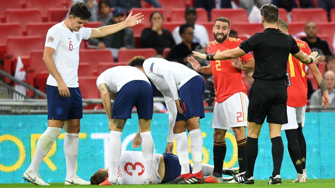Luke Shaw of England goes down injured against Spain.