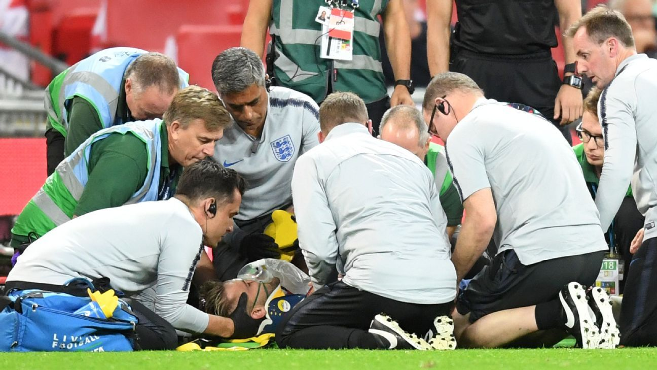 Luke Shaw of England receives medical treatment during the UEFA Nations League match against Spain.