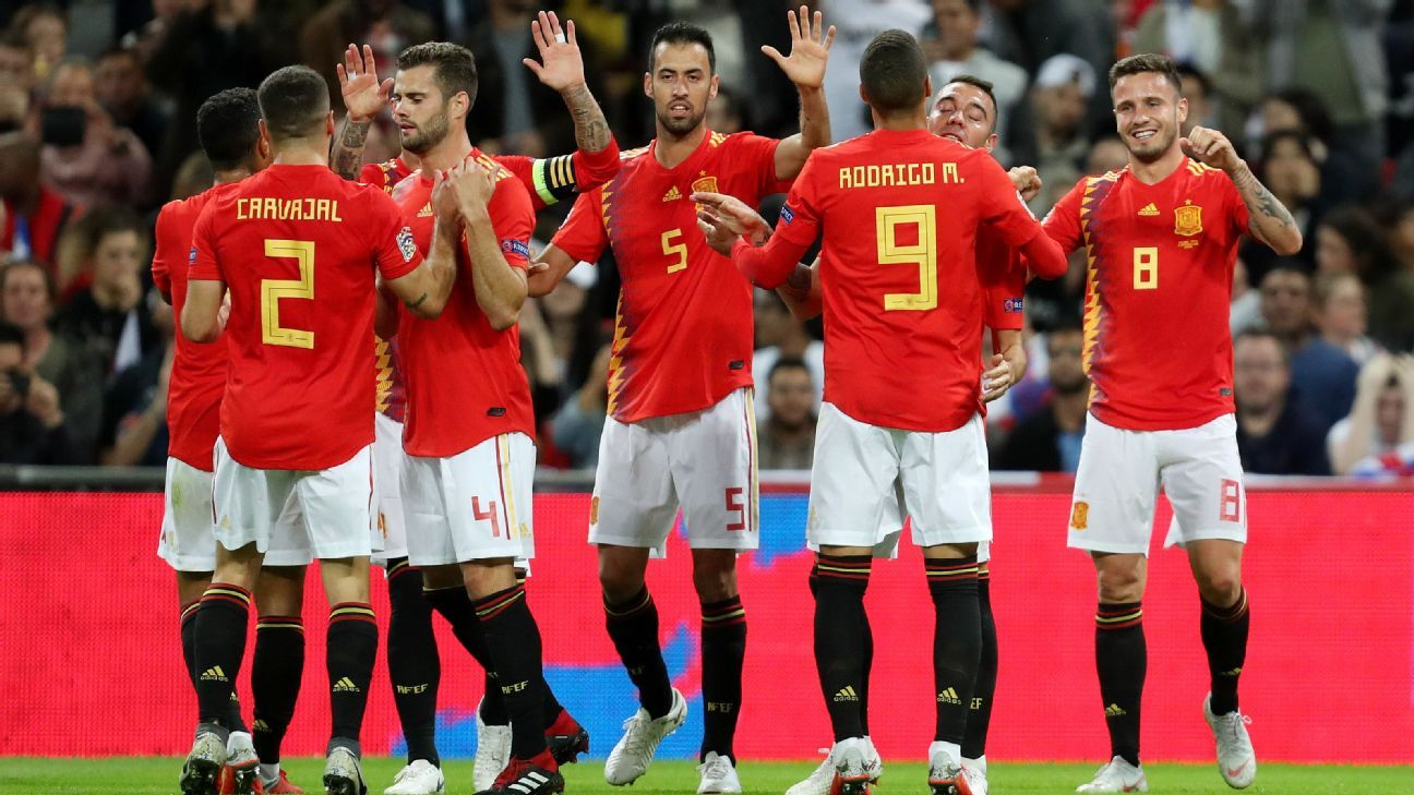 Saul of Spain celebrates with his team mates after scoring a goal against England.