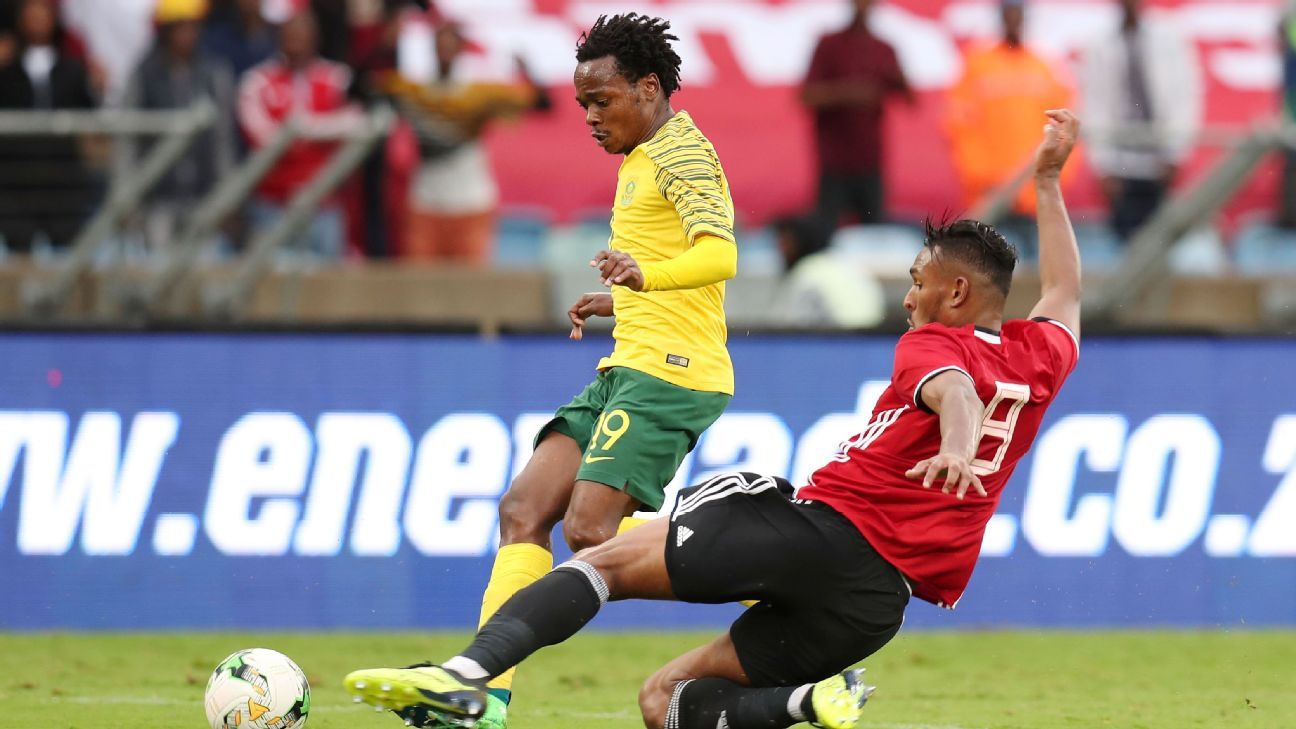 South Africa's Percy Tau is tackled by Libya's Sand Masaud Masaud during the teams' 2019 African Cup Of Nations Qualifier in Durban.