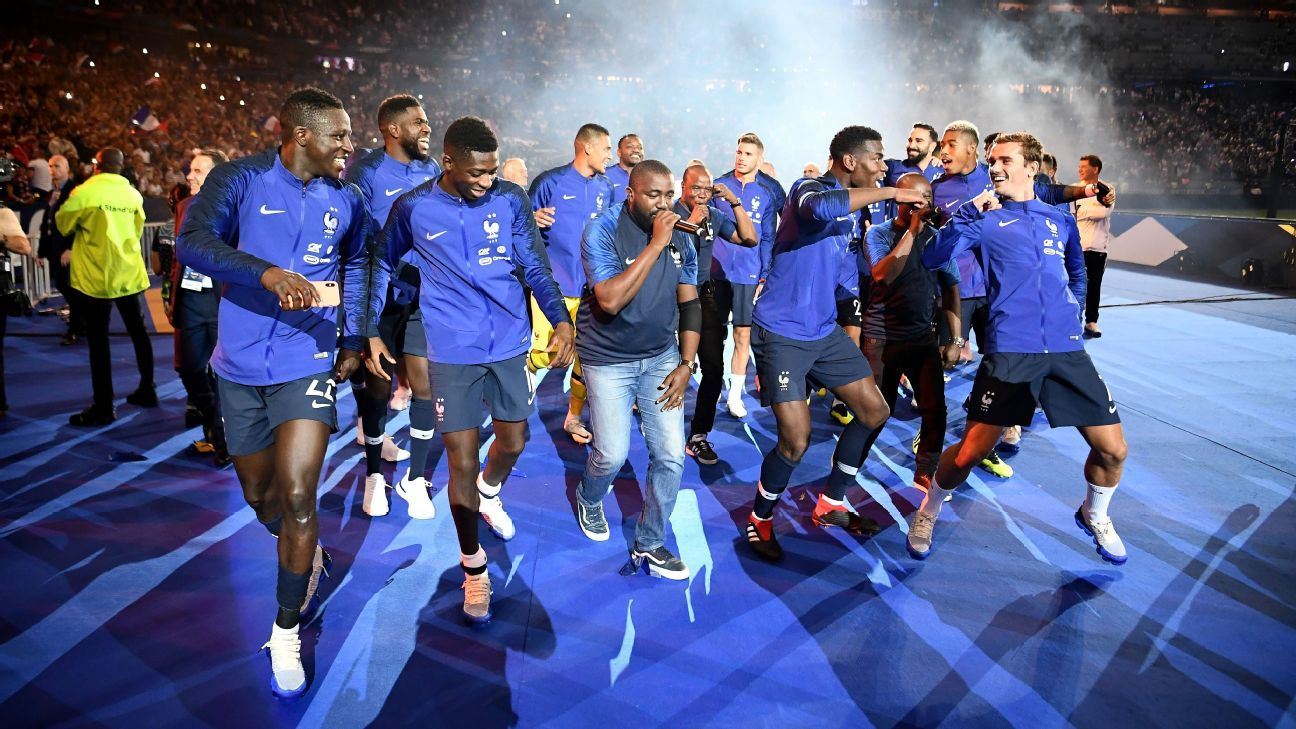 France's players celebrate as they do a lap of honour.