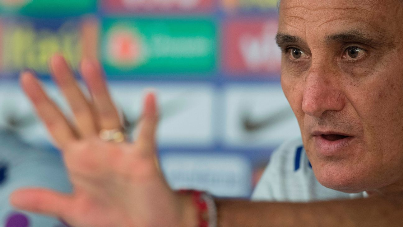 Brazil coach Tite holds up a hand to signify his team's five World Cup victories.