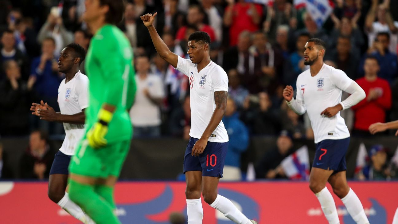 Marcus Rashford celebrates after scoring the winner in England's friendly victory over Switzerland.