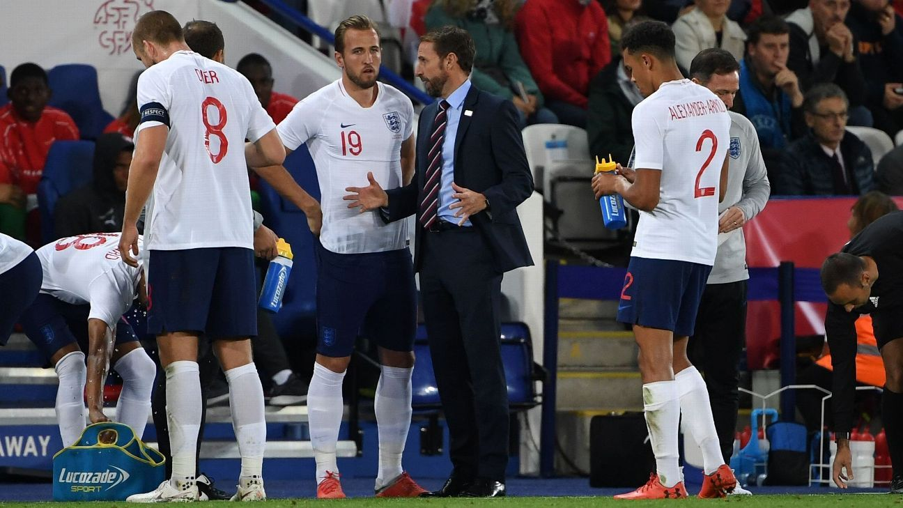Gareth Southgate and Harry Kane talk on the sidelines during an England friendly with Switzerland.