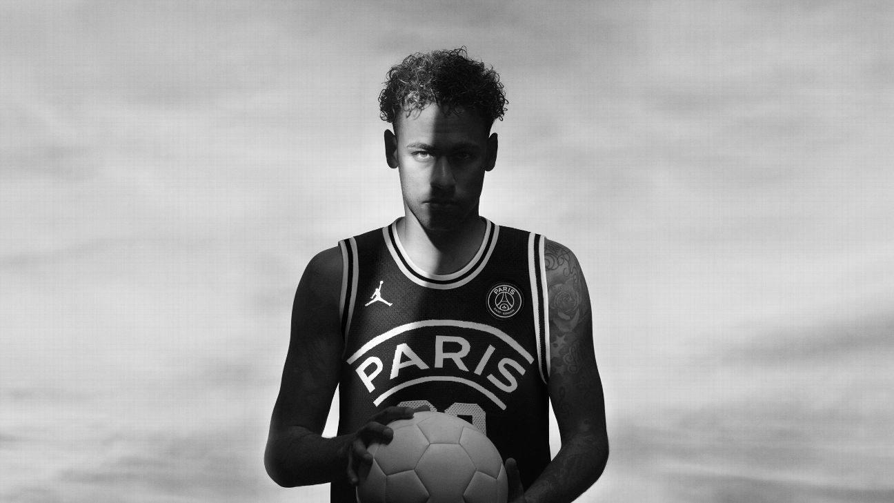 Neymar models a Jordan basketball jersey as part of a partnership with Paris Saint-Germain