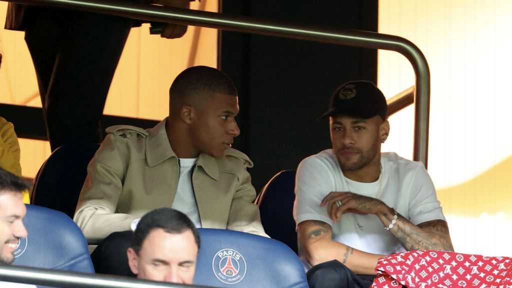 Neymar, right, speaks with Kylian Mbappe during PSG's Ligue 1 win against St Etienne.