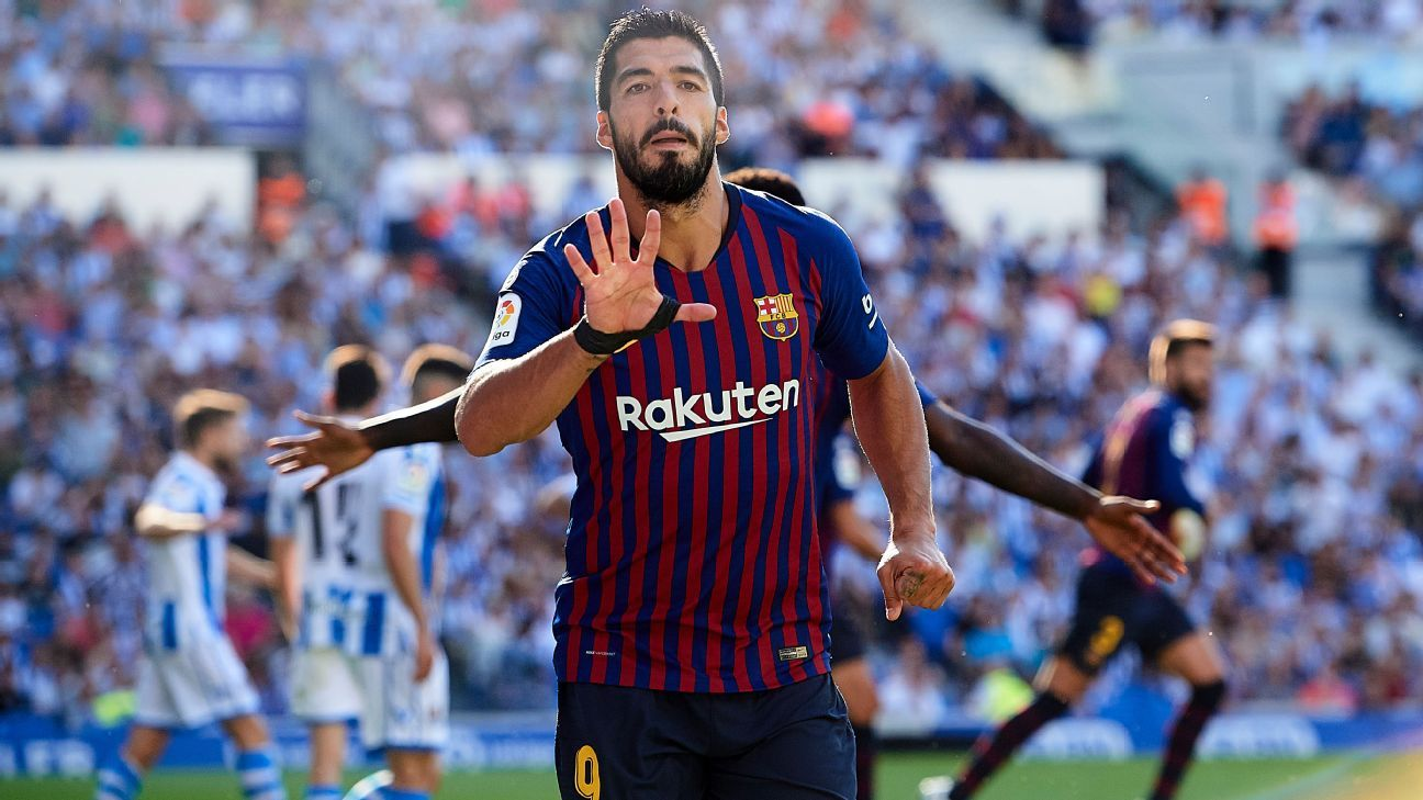 Luis Suarez celebrates after scoring for Barcelona against Real Sociedad.