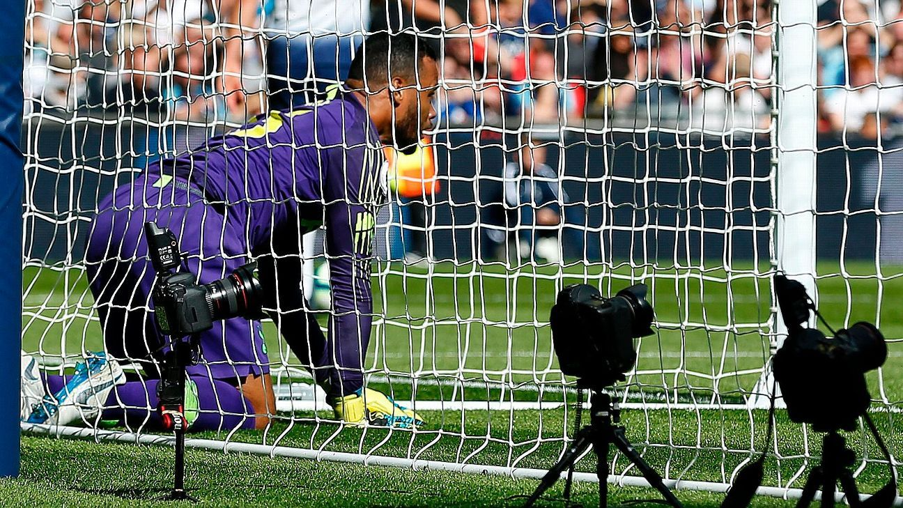 Michel Vorm reacts after a Liverpool goal o Saturday.