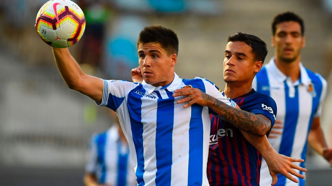 Philippe Coutinho defends against Real Sociedad's Igor Zubeldia.