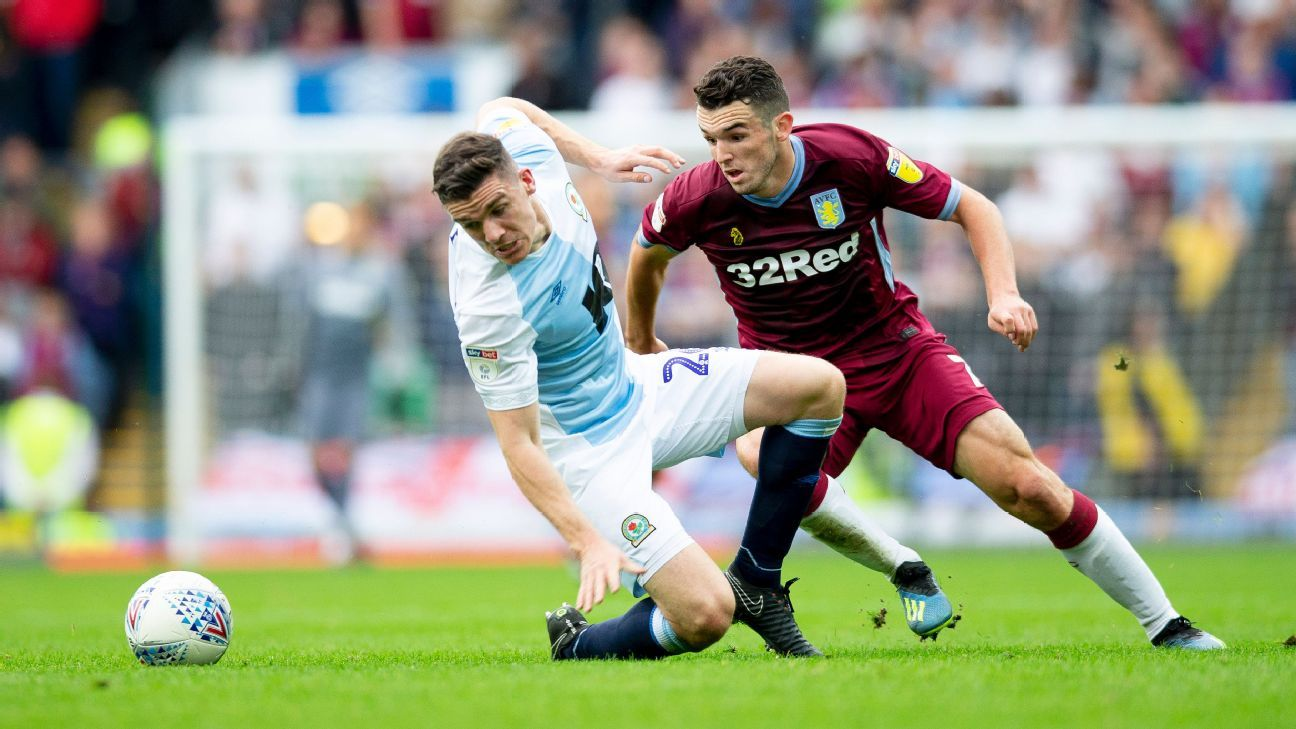Aston Villa's John McGinn battles for possession with Blackburn Rovers' Darragh Lenihan.