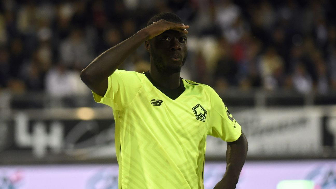 Nicolas Pepe celebrates after scoring in Lille's Ligue 1 win at Amiens.