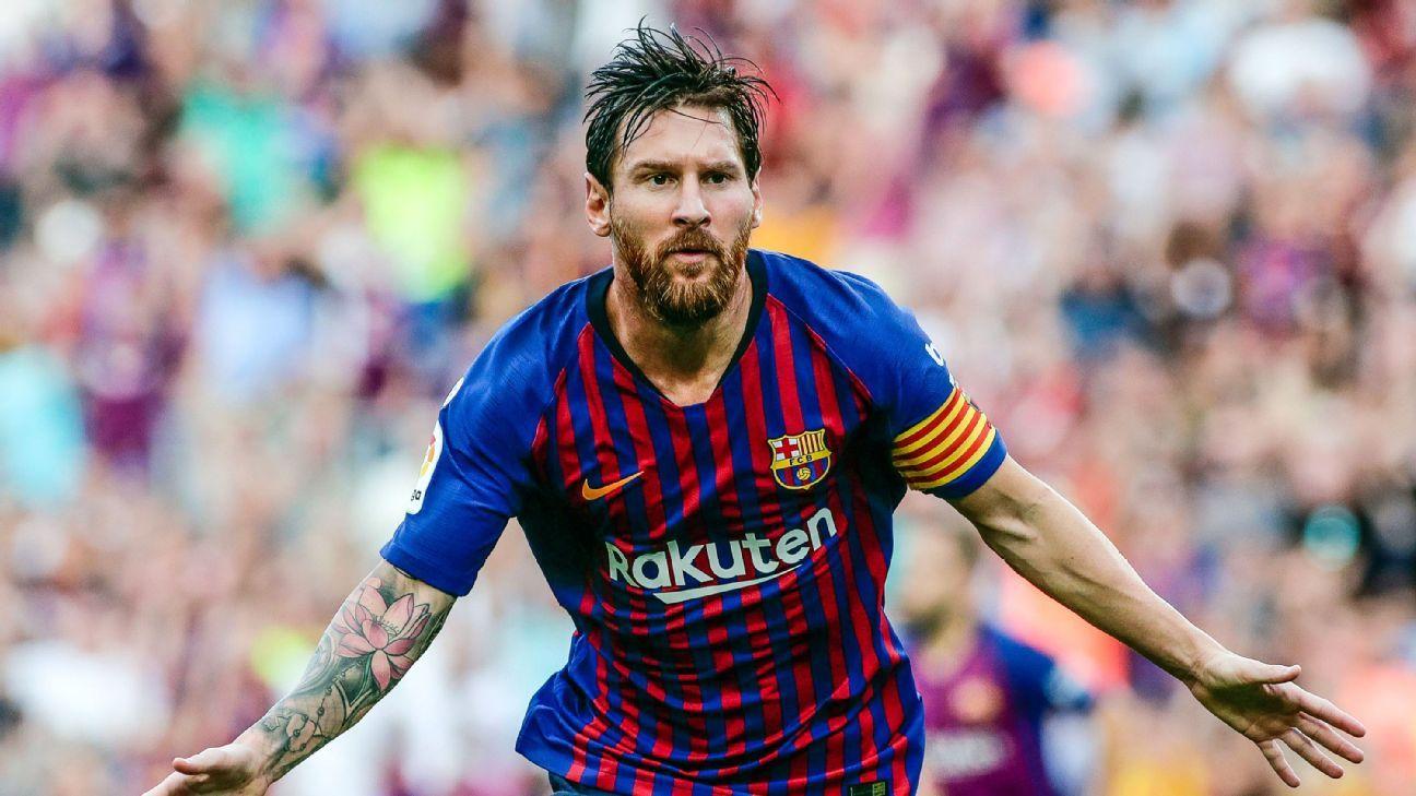 Barcelona's Lionel Messi celebrates his opener in Barcelona's 4-0 win over PSV.