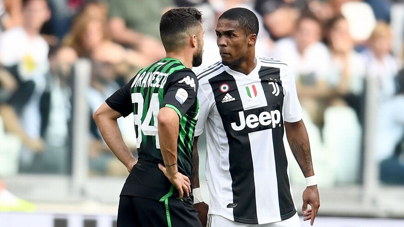 Juventus' Douglas Costa was sent off against Sassuolo after spitting at Federico Di Francesco