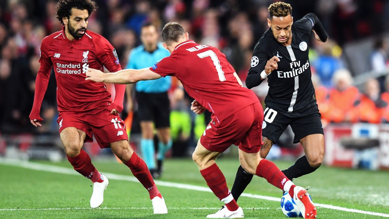 SEPTEMBER 18:  Neymar of Paris Saint-Germain is challanged by James Milner of Liverpool during the Group C match of the UEFA Champions League between Liverpool and Paris Saint-Germain at Anfield on September 18, 2018 in Liverpool, United Kingdom.