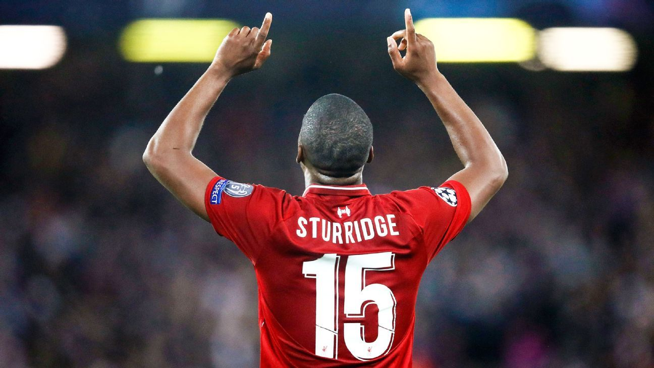 SEPTEMBER 18:  Daniel Sturridge of Liverpool celebrates as he scores his team's first goal  during the Group C match of the UEFA Champions League between Liverpool and Paris Saint-Germain at Anfield on September 18, 2018 in Liverpool, United Kingdom.