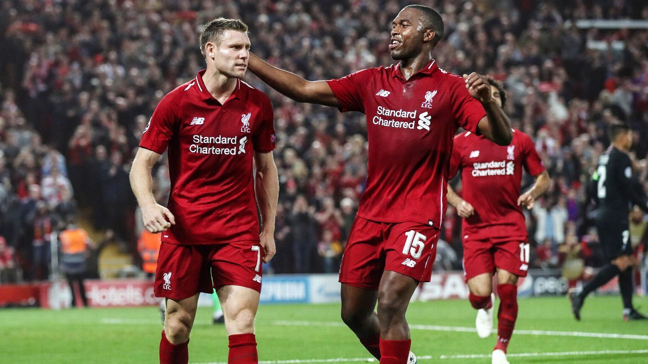 Liverpool's James Milner celebrates with Daniel Sturridge after scoring his team's second goal vs. PSG.