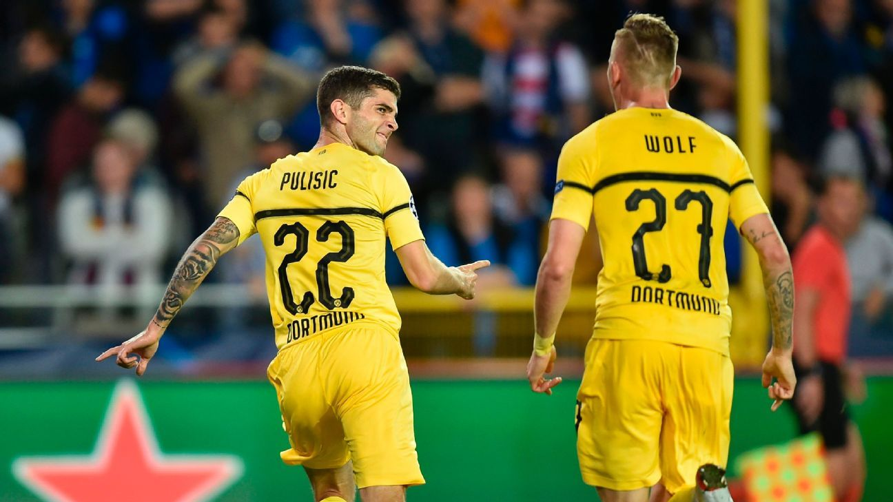 Christian Pulisic, left, celebrates after scoring a goal in the Champions League against Club Brugge.