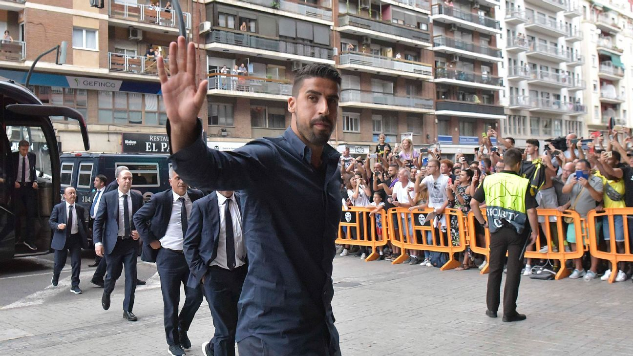 Sami Khedira and Juventus arrive in Valencia ahead of their Champions League game.