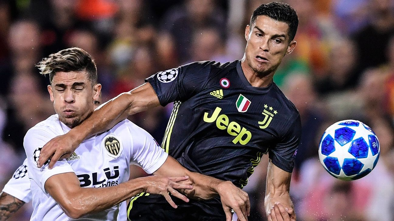Valencia's Brazilian defender Gabriel Paulista (L) vies with Juventus' Portuguese forward Cristiano Ronaldo during the UEFA Champions League group H football match between Valencia CF and Juventus FC at the Mestalla stadium in Valencia on September 19, 20