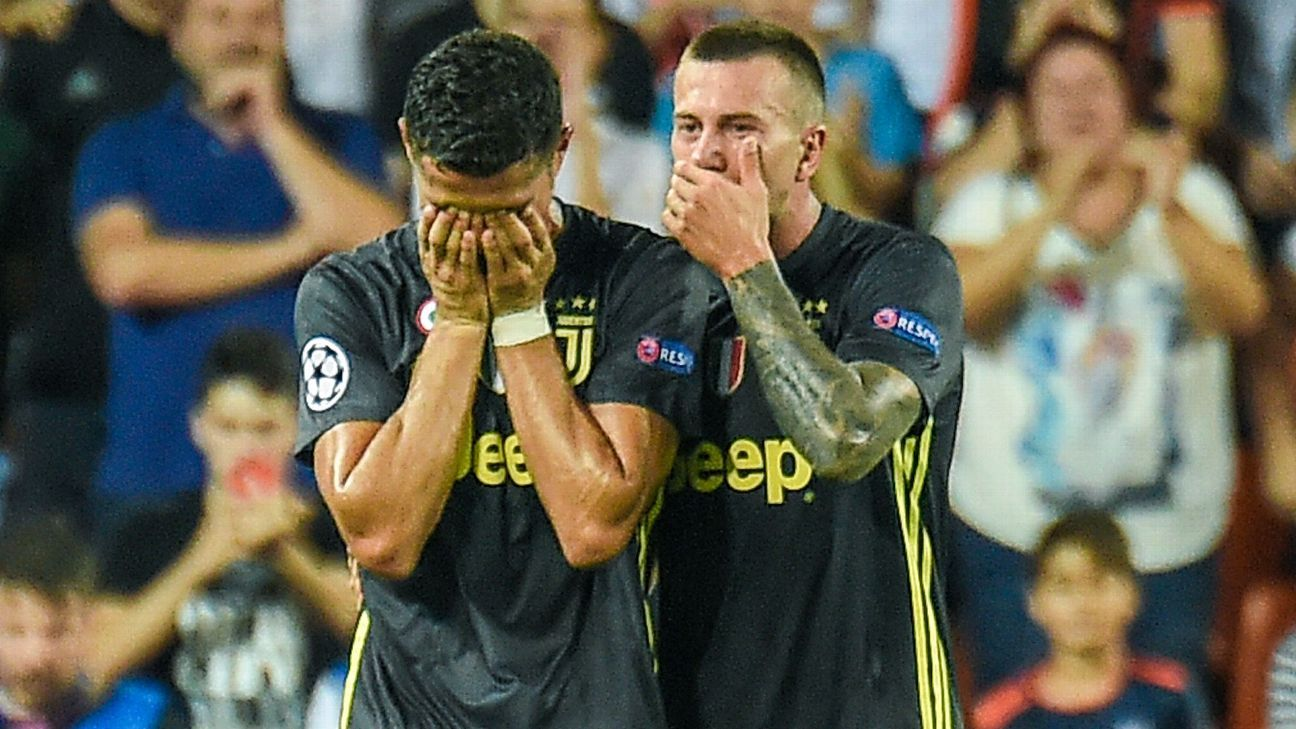 Juventus forward Cristiano Ronaldo, left, cries next to Juventus midfielder Federico Bernardeschi after receiving a red card during the UEFA Champions League Group H football match between Valencia CF and Juventus FC at the Mestalla Stadium.