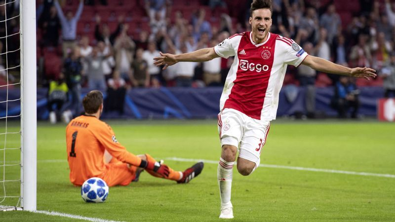 Ajax's Nicolas Tagliafico celebrates after scoring against AEK Athens.