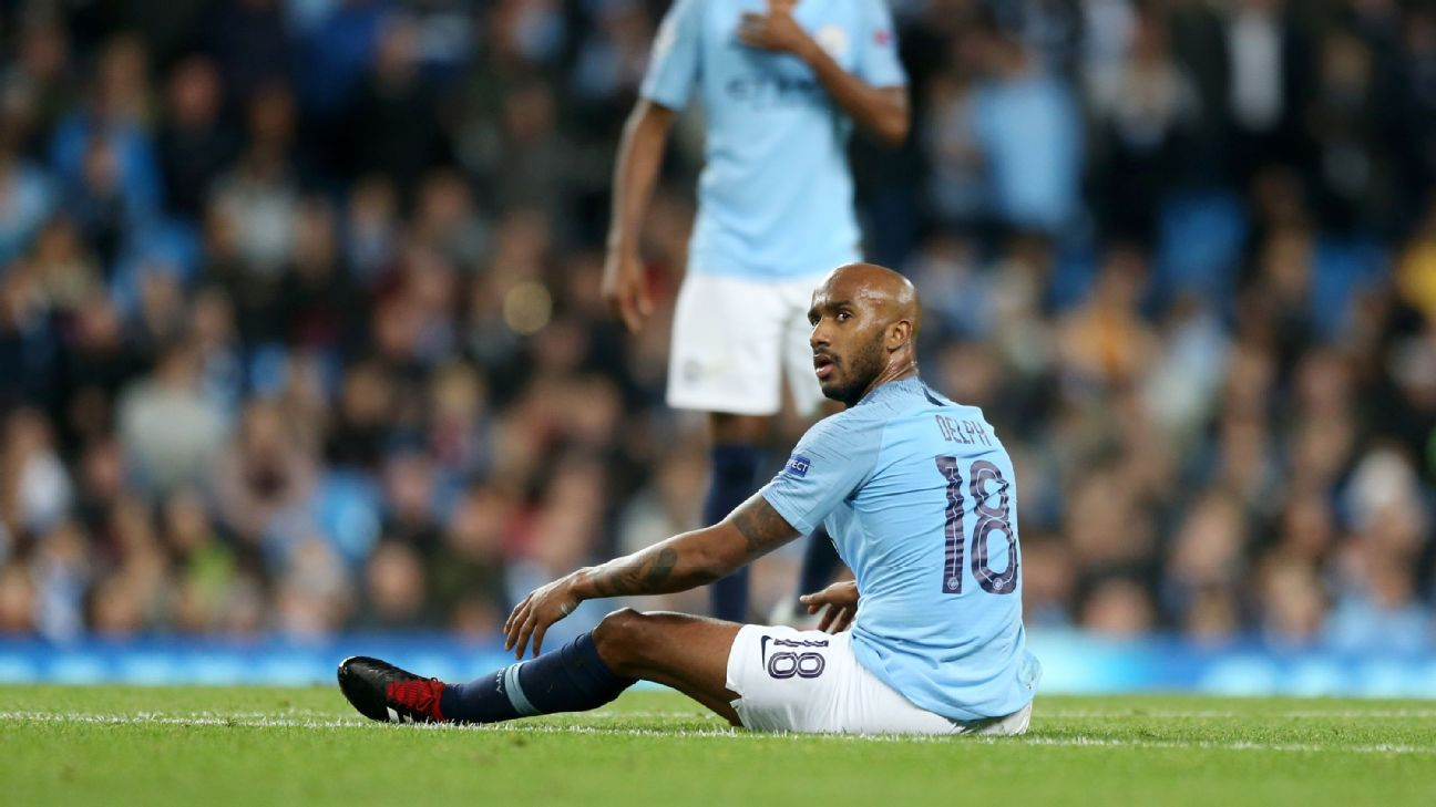 Fabian Delph looks on during Manchester City's 2-1 Champions League defeat to Lyon.