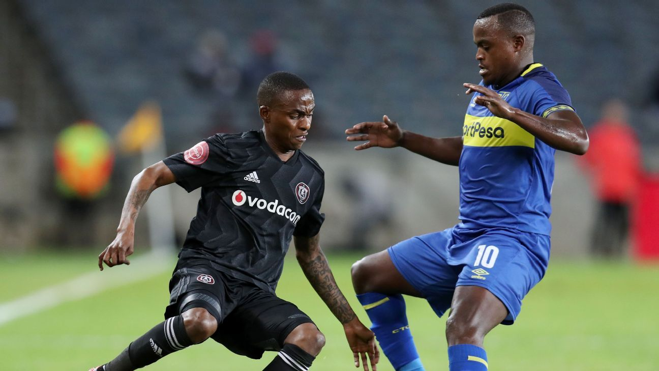 Thembinkosi Lorch of Orlando Pirates is challenged by Ayanda Patosi of Cape Town City