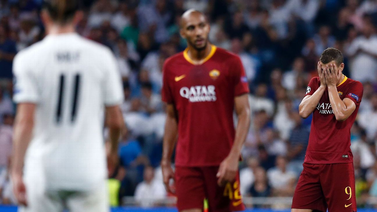 Edin Dzeko, far right, looks on during Roma's Champions League loss to Real Madrid.