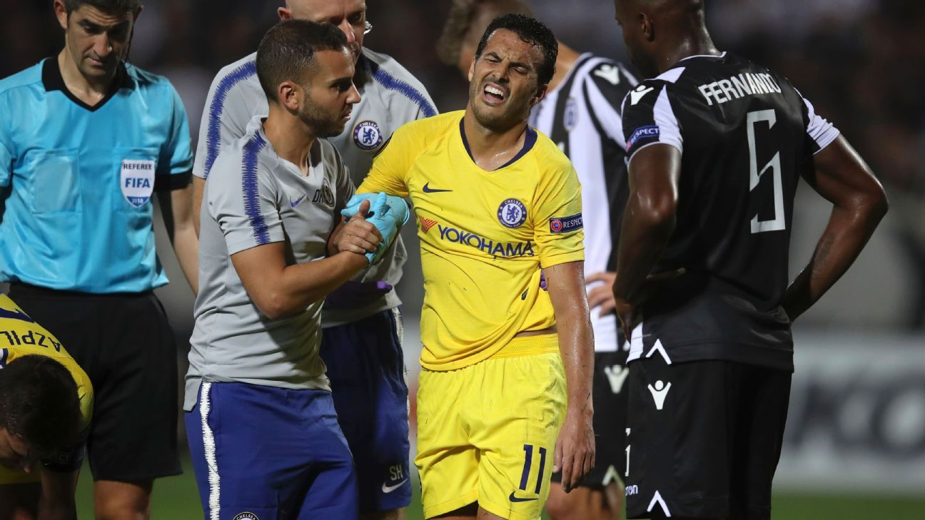 Pedro is helped off the field after a clash in Thursday's Europa League match.