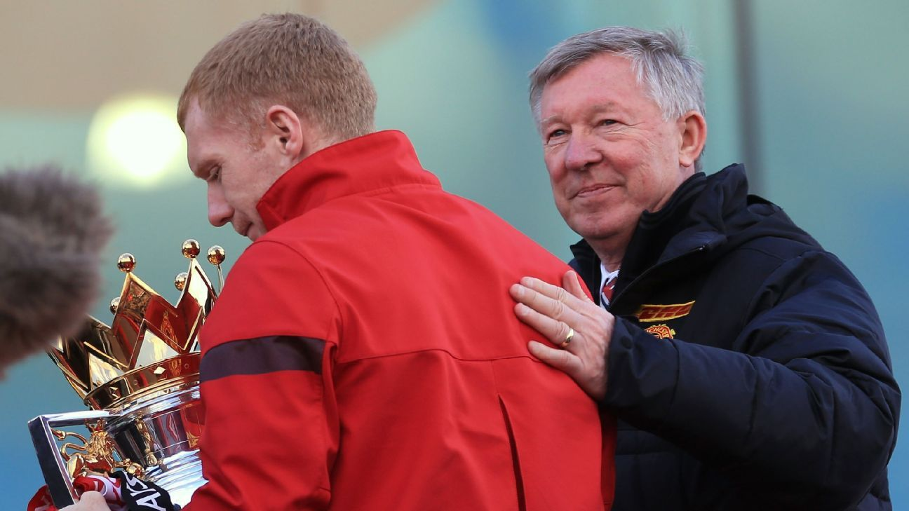 Sir Alex Ferguson, right, and Paul Scholes pictured at the 2013 parade held to celebrate Manchester United's Premier League title.
