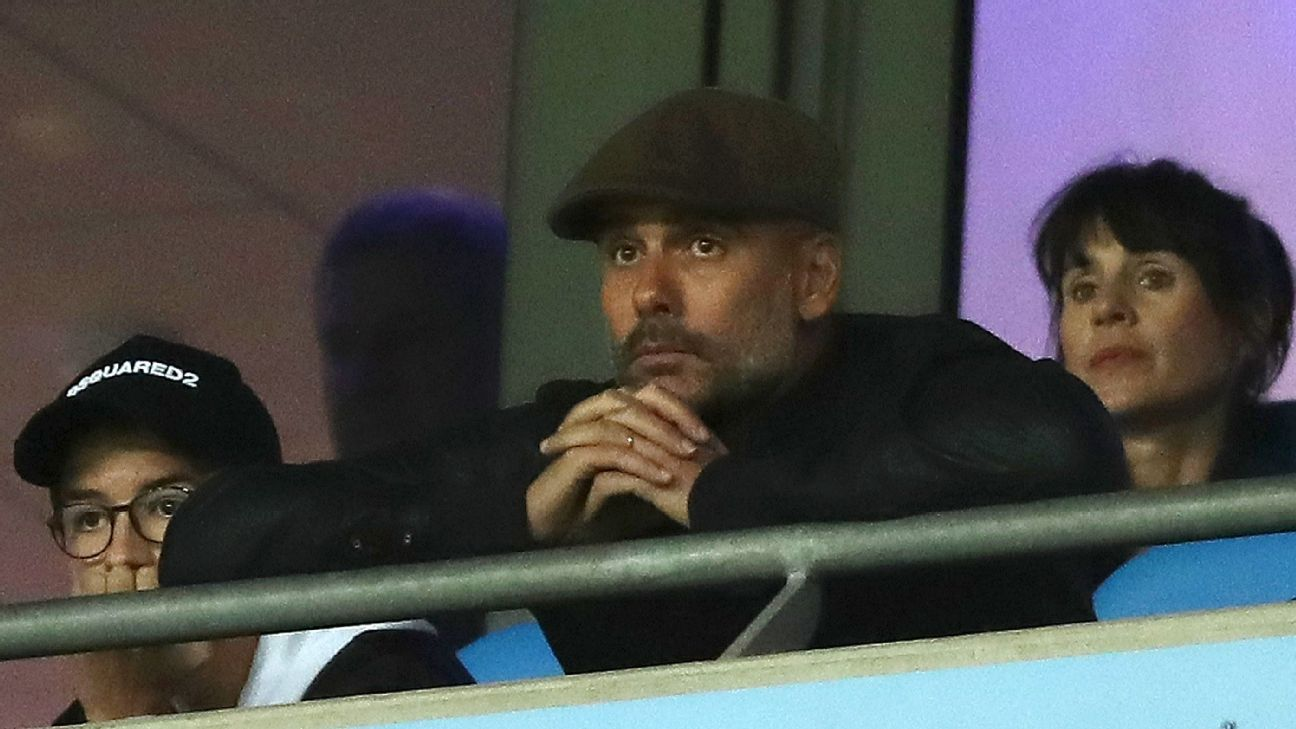 Manchester City manager Pep Guardiola watches the Lyon defeat from the stands. He's yet to experience a win at Anfield.