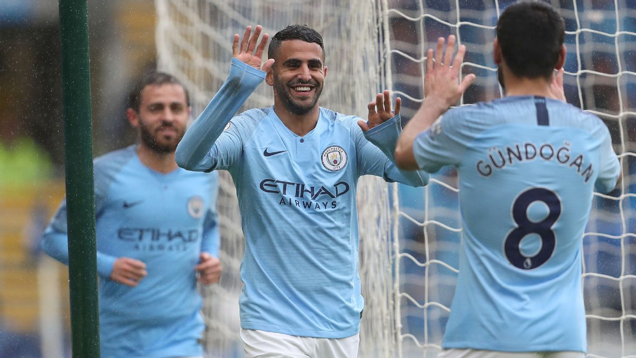 Riyad Mahrez celebrates after scoring Manchester City's fourth goal in the win against Cardiff.