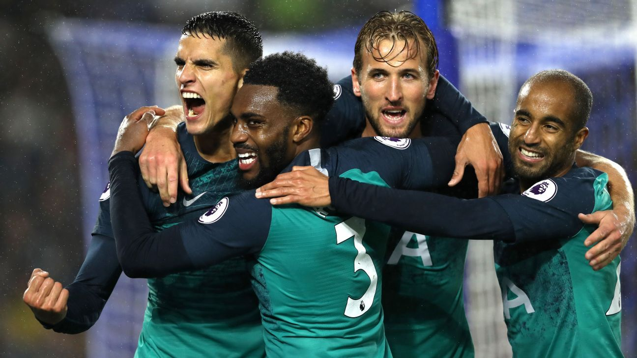 Erik Lamela celebrates with his Tottenham teammates in the Premier League win against Brighton.